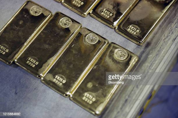 One kilogram gold bars sit on a tray at the Perth Mint Refinery operated by Gold Corp in Perth Australia on Thursday Aug 9 2018 Demand for coins and...