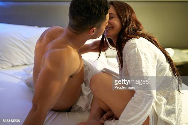 one kiss leads to another - heterosexual couple photos stock photos and pictures