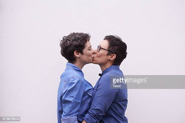 one kiss...a thousand feelings - lesbian dating stock pictures, royalty-free photos & images