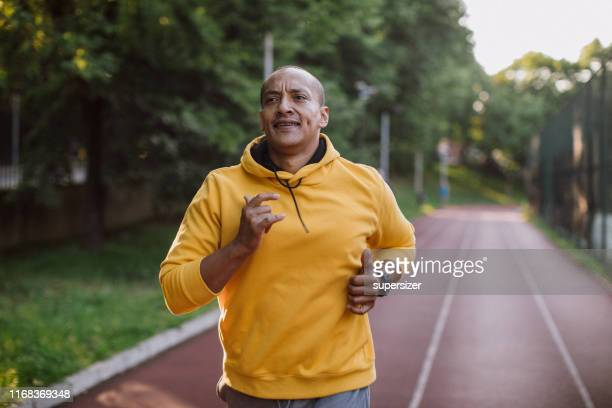 one latin man exercising outdoors - sporting term stock pictures, royalty-free photos & images