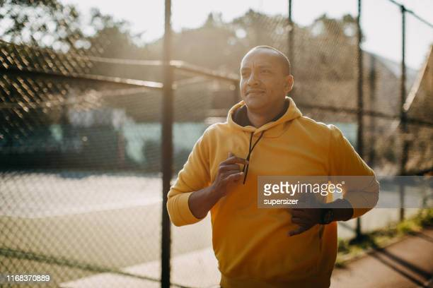 one latin man exercising outdoors - active lifestyle stock pictures, royalty-free photos & images