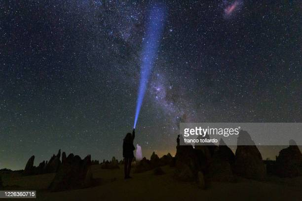 one light under the milky way - central california stock pictures, royalty-free photos & images