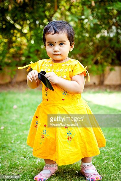 one little indian girl outdoor portrait full length - indian baby stock photos and pictures