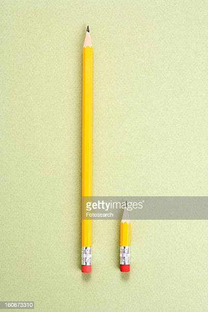 One long pencil and one short pencil placed side by side in comparison