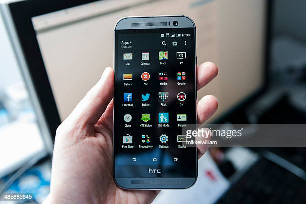 htc one m8 - android phone made from aluminium - high tech computer corporation stock pictures, royalty-free photos & images