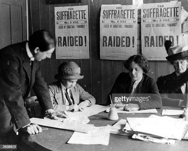 One man and three women in the suffragettes office.