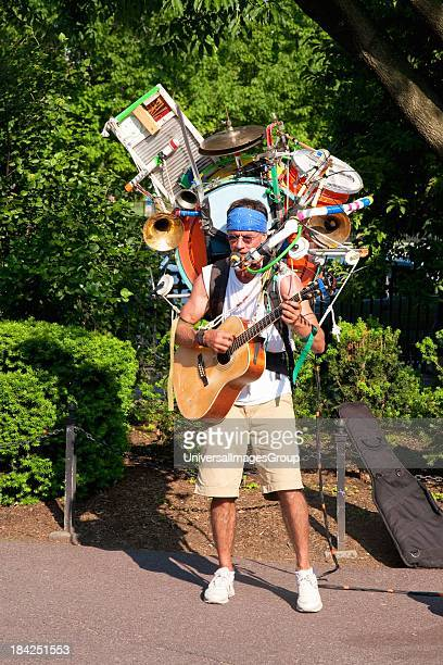One Man Band and musician plays in Public Gardens Boston MA