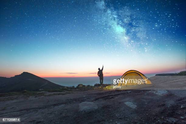 one man camping at night with phone - camping stock photos and pictures