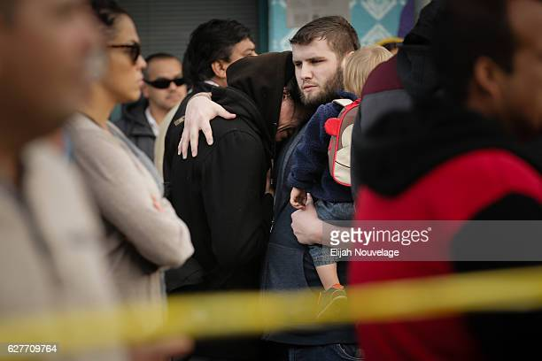 One man consoles another as he cries near the site of a warehouse fire that has claimed the lives of at least thirtythree people on December 4 2016...