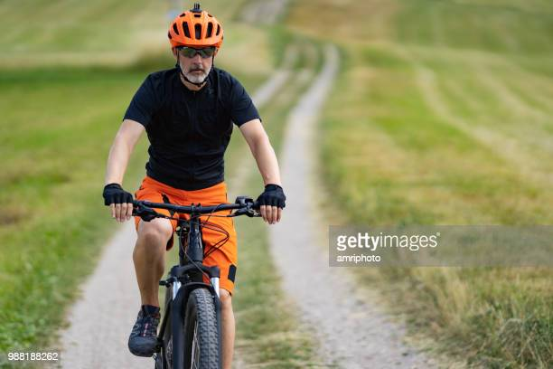 one man cycling on his e mountainbike