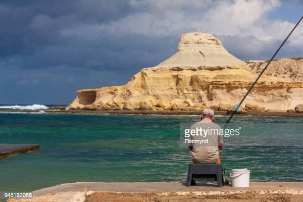 One man fishing in Xwejni bay, Gozo
