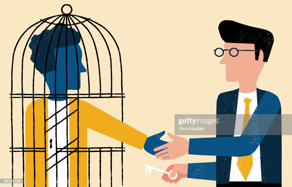 one man in cage shaking hands with business man with key : Stock Photo