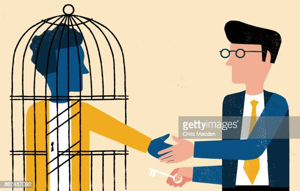 one man in cage shaking hands with business man with key