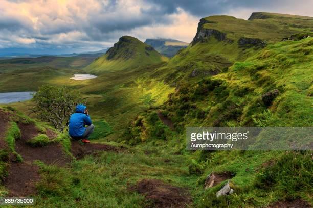 One man in Quiraing, Isle of Skye, UK.