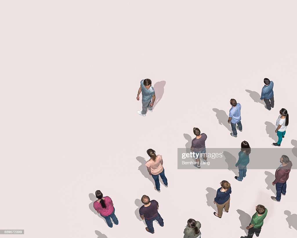 One man looking at crowd behind him, Aerial View : Stock Photo