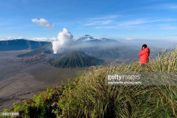 one man looking at the  view of mt.bromo, indonesia - mt bromo stock photos and pictures