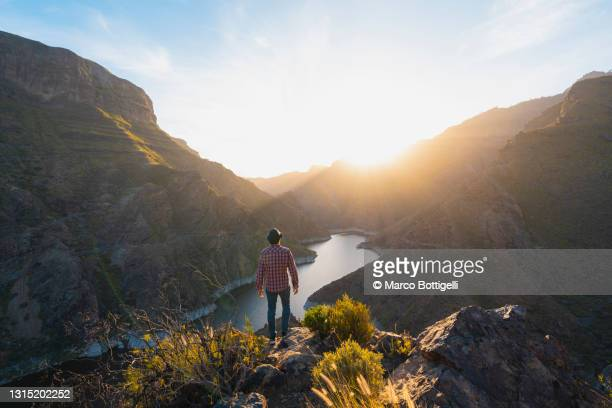 one man looking at view in the mountains of grand canary, spain - tejeda canary islands stock pictures, royalty-free photos & images
