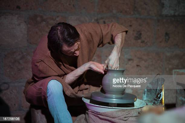 One man occupied in pottery production in living nativity scenes of Christmas in Bethlehem on 25 december 2012 at Civita di Bagnoregio. Viterbo,...