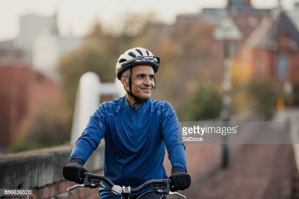 one man riding on the sidewalk - barrier highway stock photos and pictures