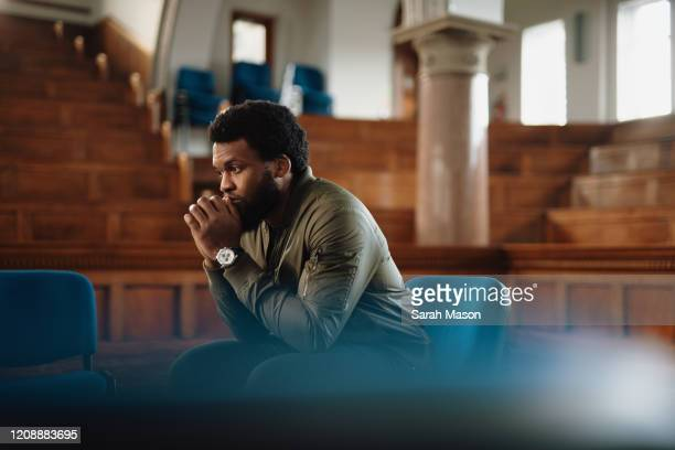 one man sits and thinks - men stock pictures, royalty-free photos & images