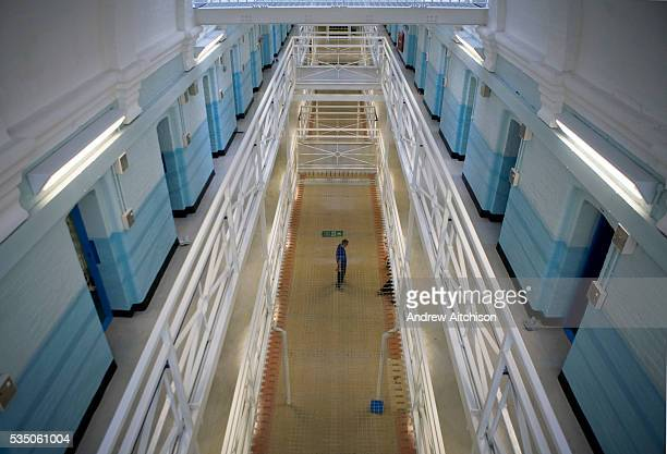 One man standing in the main hall of the newly refurbished E wing at Wandsworth prison HMP Wandsworth in South West London was built in 1851 and is...