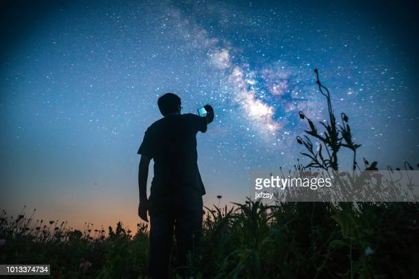 one man standing in the wild looking forward - calculating stock pictures, royalty-free photos & images