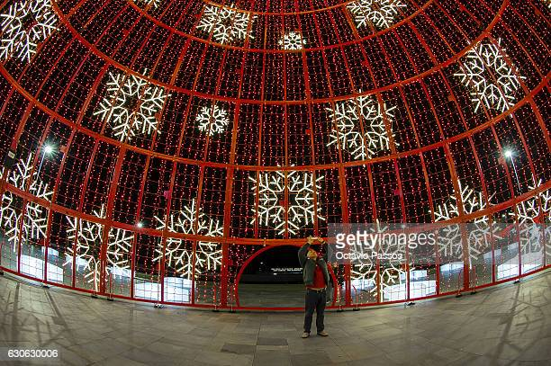 One man take one picture into a Christmas tree of lights on December 29, 2016 in Funchal, Madeira, Portugal.