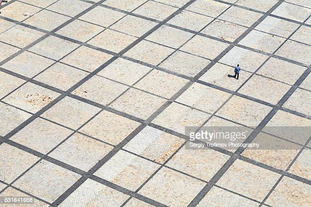 One man walking on town square