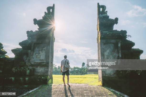 one man wandering in bali, indonesia - balinese culture stock pictures, royalty-free photos & images