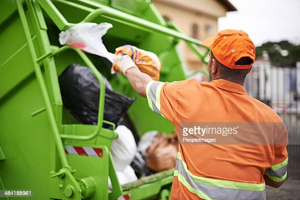 one man's trash... - street sweeper stock pictures, royalty-free photos & images