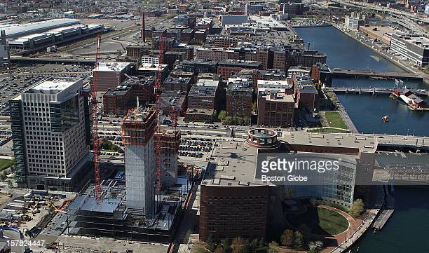 One Marina Park Drive Vertex buildings under construction in the foreground with the Moakely Courthouse on the right looking away from the waterfront...