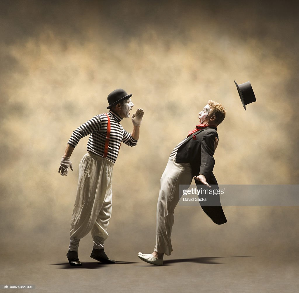 One mime yelling at another : Foto de stock