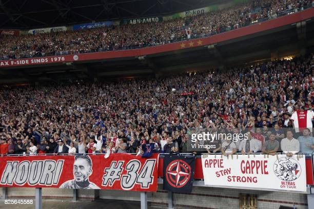 One minute applause for Abdelhak Nouri of Ajax banner of Abdelhak Nouri of Ajax during the UEFA Champions League third round qualifying first leg...