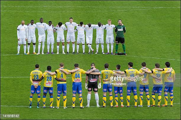One minute of silence in memory of the bus crash in switzerland during the Jupiler League match between Westerlo and KRC Genk on March 18, 2012 in...