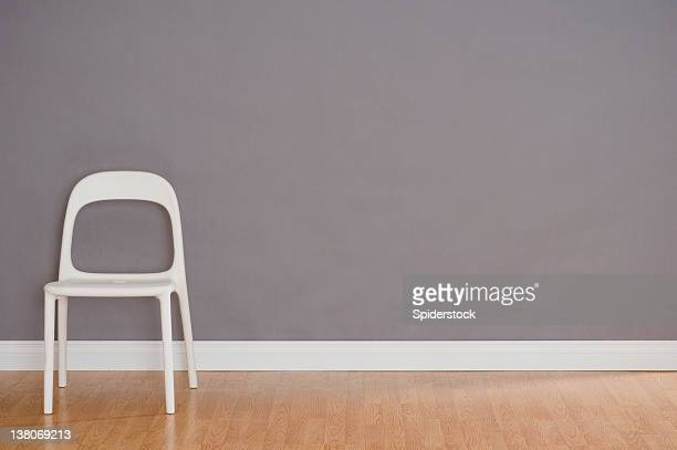 one modern plastic chair - wainscoting stock photos and pictures
