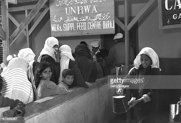 One month after Israel's first occupation of this wartorn area Arabs receive their milk rations at a United Nations distribution center December 1...