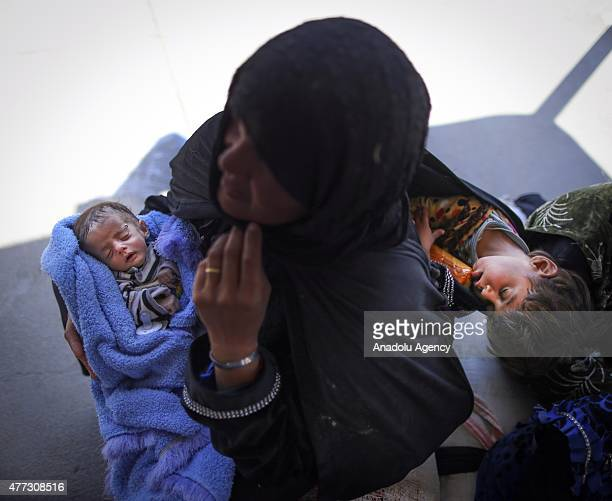 A one month old Syrian baby sleeps in his mother's arms after crossing into Turkey from Akcakale Border Gate in Sanliurfa Turkey on June 16 2015...