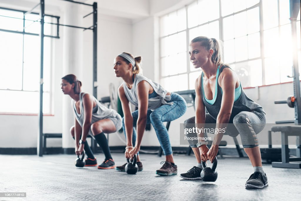 One more squat and we're done! : Stock Photo