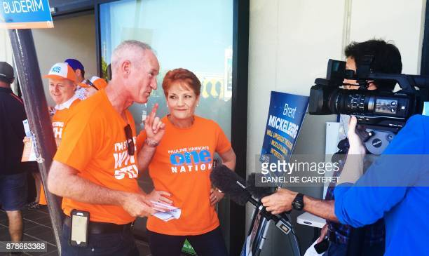 One Nation leader Pauline Hanson listens to a supporter being interviewed in Buderim near Brisbane on November 24 2017 Voters in the Australian state...