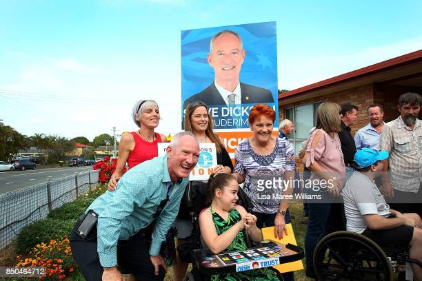 One Nation Senator Pauline Hanson and Queensland party leader Steve Dickson take photos with local supporters during a barbeque in Buderim on...
