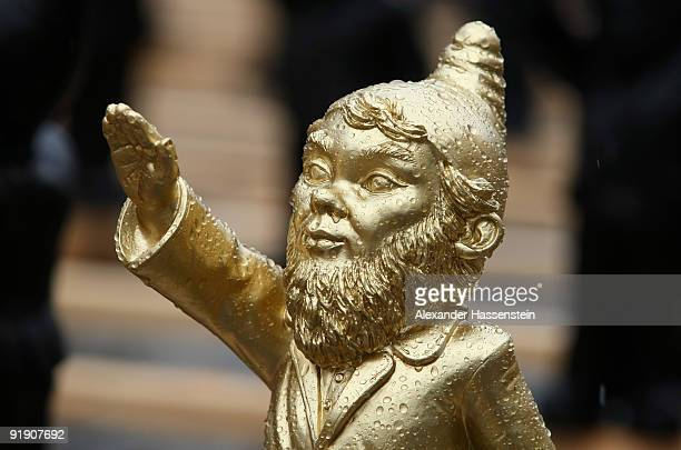One of 1250 garden gnomes with their right arms raised in a Hitler salute is seen as part of the art installation 'Dance with the Devil' in the main...