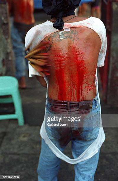 One of 200 inmates that performed self flagellation on Good Friday The ritual is to show repent for their crimes and to bring good luck back to their...