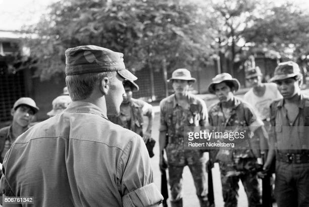 One of 55 US Army trainers checks targets of Salvadoran soldiers during a training exercise in San Miguel El Salvador August 1 1984 The US began to...