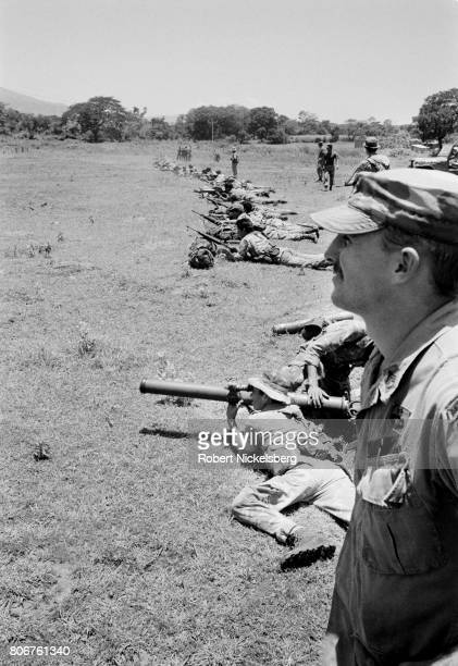 One of 55 US Army trainers right observes Salvadoran soldiers during target practice in San Miguel El Salvador August 1 1984 The US began to equip...