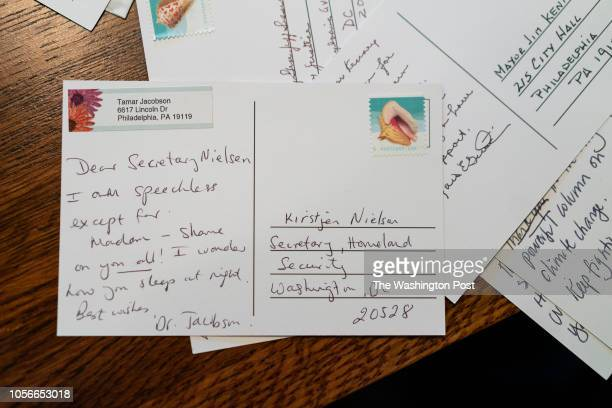 One of a group of women who gather every week in each others homes to write postcards in the Mt Airy neighborhood of Philadelphia Pennsylvania writes...