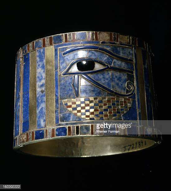 One of a pair of bracelets found on Shoshenq IIs body with representations of the Wedjat eye upon a basket The eyes are depictions of the eyes of the...