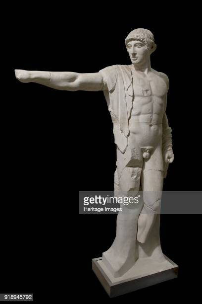 One of a set of sculptures and metopes from temple of Zeus at Olympia c460 BC Apollo west pediment 460 BC Figure of naked Apollo The hair held by...
