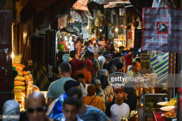One of a very busy narrow streets inside Fes Medina A scene from a daily life in Fes during the Ramadan 2017 On Monday June 19 in Fes Morocco