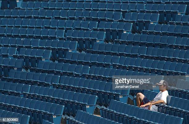 One of about 4000 fans watch as the Florida Marlins take on the Montreal Expos in a game on September 13 2004 at US Cellular Field in Chicago...