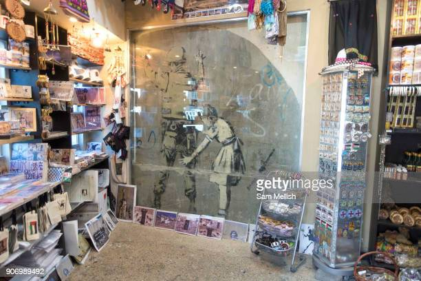 One of Banksys most iconic street art graffiti now enclosed in a unofficial Banksy shop on 1st April 2016 in Bethlehem West Bank During the Palestine...
